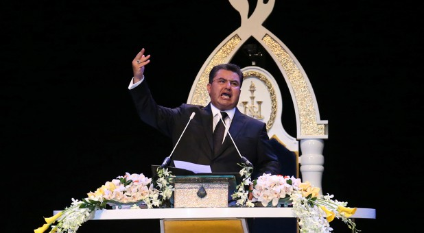 Naason Joaquin Garcia, the spiritual leader and international director of The Light of the World Church, gestures as he leads the prayer session at Mexico City Arena in Mexico City.