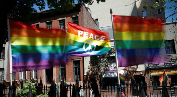 Rainbow flags wave in the wind at the Stonewall National Monument outside the Stonewall Inn.