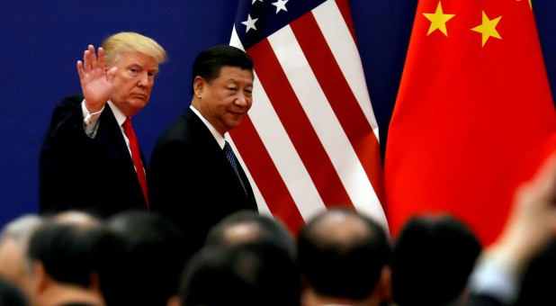 U.S. President Donald Trump and China's President Xi Jinping meet business leaders at the Great Hall of the People in Beijing.