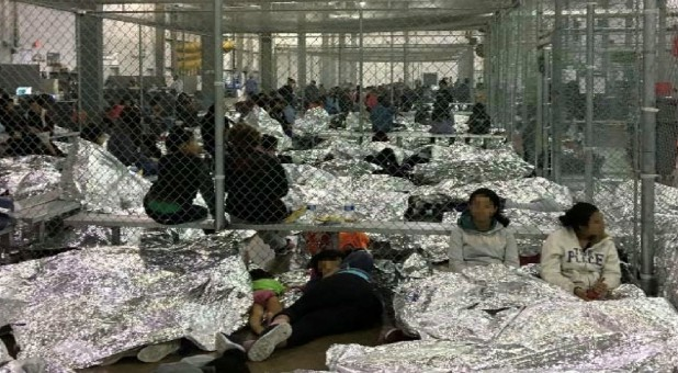 An overcrowded fenced area holding families at a Border Patrol Centralized Processing Center is seen in a still image from video in McAllen, Texas, U.S., on June 11, 2019. and released as part of a report by the Department of Homeland Security's Office of Inspector General.