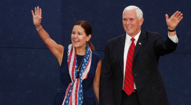 U.S. Vice President Mike Pence and and his wife, Karen, wave to the crowd.